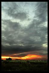 Green, Orange and Gray (john edward) Tags: sunset sky green grass top20sunrisesunset 85points