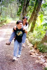 Love (archangel_raphael) Tags: camera green love film yellow 35mm catchycolors happy support nikon close sweet philippines joy hike relationship backpack pointandshoot laughter caring intimate davao mindanao fulfilled edennaturepark