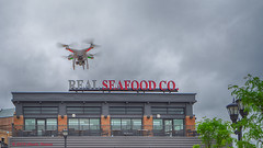 _DSC7784 Seafood Drone Delivery (Charles Bonham) Tags: clouds restaurant flying outdoor seafood flyover drone gopro realseafoodco baycitymi goprocamera saefood uptownbaycity realseafoodcorestaurant