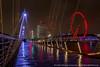 Golden Jubilee Bridge (Splendid What) Tags: cityscape goldenjubileebridge london londoneye night nightscene nightshot rain riverthames shellbuilding southbank wet