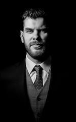 Corleone (Wojtek Piatek) Tags: mafia movie film sony a99 50 sigma art portrait male handsome one light umbrella hss 50mm tie suit beard poland dublin ireland