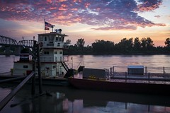 Missouri River Sunset II (Notley) Tags: bridge sunset sky orange reflection water colors clouds ro river boat glasgow gear august rivire missouri tug fluss reflexion jumbo reflexin missouririver  howardcounty  2015  bardge 10thavenue odraz glasgowmissouri notley  ruralphotography   eftertanke notleyhawkins missouriphotography httpwwwnotleyhawkinscom notleyhawkinsphotography