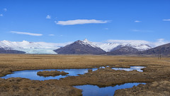 All I wished for was to be a duck in these ponds ;) (lunaryuna) Tags: iceland southeasticeland landscape panoramicviews mountainrange glacier glaciertongue ponds marshes marshgrass snowcappedmountains vastness beauty spring season seasonalchange water reflections sky clouds lightmood lunaryuna