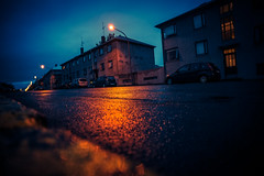 Reykjavik 2am (K. McMahon) Tags: rauðarárstígur angle apartments city clouds dark europe iceland lamps light lights midnightsun midsummer night noir rain reflection reykjavik street summer wide wideangle