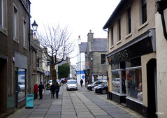 One Of Kirkwall's Main Shopping Streets (orquil) Tags: albertstreet narrow flagstones oneway shopping street nopavement pedestrian priority shops leafless bare tree thebigtree kirkwall town royalburgh january afternoon winter car shoppers locals orkney islands scotland uk unitedkindom greatbritain orcades urban scene interesting