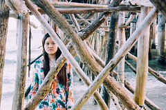 70/365: under the docks ii (Yen Thu McGrath) Tags: ocean wood sea portrait beach water docks project indonesia photography woods waves poles 365 photoproject photochallenge project365 365dayproject telunas