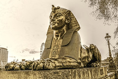 Sphinx (vampire-carmen) Tags: city uk greatbritain england sky london history statue sphinx thames sepia photoshop river reisen esfinge unitedkingdom egypt himmel londoneye stadt lantern traveling fluss laterne hdr sfinge themse strassenszene geschichte grossbritannien sfinks urbanstreetscene  sphinge gyptisch sfinga  sfinksi vereinigtesknigreich sfenks esfinx sfinksas    szfinksz   sffincs canoneos600d    redfieldpluginfinetouch    sfinkso orangygmerahasiakanpendapatnya        ngikhhiu  khafrae   sphinx