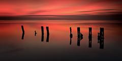 Sentinels 1 (Langstone Joe) Tags: sentinels portsmouthharbour havant haylingisland hampshire seascape billyline sunset reflections langstone longexposure