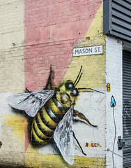 The Bee of Mason Street (PDKImages) Tags: art street manchesterstreetgallery manchesterstreetart streetart contrasts couple love artinthecity ripartist faces abandoned girl bee bees manchester walls posterart stencilart heart hidden dmstff cityscape cityscene