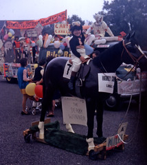 Not going to bolt (theirhistory) Tags: carnival parade boy child horse static mounted hat ridingboots road street floats jacket breeches jodhpurs