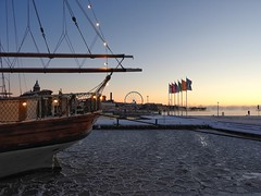 Dawn at the Helsinki harbor on a wintry morning (KaarinaT) Tags: ice winter helsinki finland sailship koleeraallas kauppatori themarketplace sailboatinice dawn morning sunrise early ferriswheel harbor city seafront kaartinkaupunki