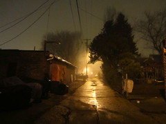 night alley in fog, wide view (Zombie37) Tags: night scene fog foggy mist light dark yellow glow alley street landscape urban baltimore city hampden maryland american usa eclectic shapes buildings wires gold tree wet concrete lines