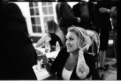 KathrynBill10.8.16_188  Frederick Maryland Film Photographer Frederick Maryland Wedding Photographer Martyr And Lee Photography (Johnny Martyr) Tags: blonde girl woman tattoo arm glass wine smile talk social teeth contrast alternative indie beautiful pretty armtattoo tattoos armtattoos ink style blondestylishgirl stylishblondewoman reception party wedding weddingreception hittingon talkingto flirting flirty flirtingwith fixinghair touchinghair blondehair jaw jawline film 35mmfilm bw blackandwhite portrait candid documentary photojournalism composition moment nikon nikkor f2sb 50mm ilford delta3200 6400 pushprocessing ilforddelta6400 6400iso kodak kodakhc110 hc110b grain grainy natural face shallowdepthoffield sharpeyebrows steepjaw womaninblazer girlinblazer fullglassofwhitewine frederickmarylandweddingphotographer frederickmarylandweddingphotography martyrandleephotography weddingphotojournalistmaryland filmweddingphotographermaryland