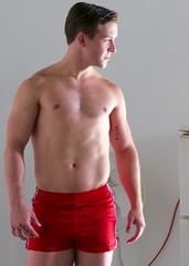 IMG_8188 (danimaniacs) Tags: shirtless man hot sexy guy muscle hunk shorts redshorts mansolo chicosangels