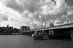 DSC_0391 (Valantis Antoniades) Tags: bridge england bw white black london water thames architecture modern clouds river britain united great engineering kingdom pedestrian hungerford cables