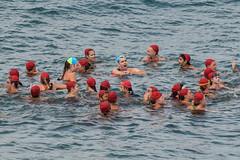 Red Caps (Jose Matutina) Tags: ocean california sea man guy beach sport unitedstates pacific wave competition surfing dude vans orangecounty huntingtonbeach lifeguards usopen