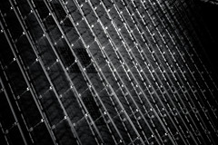 Holographic Storage (Skuggzi) Tags: uk england blackandwhite bw abstract building london geometric glass monochrome lines metal architecture modern facade grid europe noir unitedkingdom britain geometry minimal lookingup lookup gb scifi slats docklands sciencefiction hightech sunlit futuristic cyberpunk technoir louvres