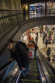 Witness Against Torture Protesters Ascend the Escalator from the Union Station Food Court