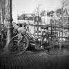 Bike (Arne Kuilman) Tags: film ilford xp2 iso400 rolleicord 6x6 mediumformat amsterdam nederland netherlands straat street scan v600 bokeh fiets bicycle wreck wrak chained dutch