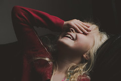 Young Girl | Camera Shy (milkybargeek) Tags: red girl female laughing shy cardigan embarrased