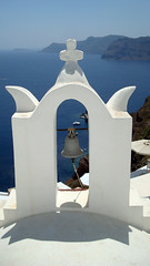 Santorini Oia Bells (Jae at Wits End) Tags: ocean blue light sea white mountain building church water rock metal architecture bells outside island harbor dock marine europe arch shadows exterior cathedral bell outdoor structure hills landing santorini greece coastal instrument bluewhite geological