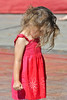 Problem Solving (swong95765) Tags: red dress girl wet water fist young concentrating kid cute
