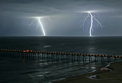 Sometimes Overlooked (lightonthewater) Tags: lightning lightonthewater ocean waves gulfofmexico panamacitybeach pier clouds storm thunderstorm