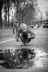Mirror Me (Mark van Oirschot) Tags: water reflection blackandwhite black white bw fuji xt10 56mm portrait child thinking puddle wet leaves street boxtel netherlands