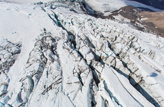 Glacier on Eyjafjallajkull.  Note the dark ash in the fissures as they open up during the melting and moving process. (stevebfotos) Tags: volcano iceland tour south glacier helicopter glaciers eruption aerials eyjafjallajkull nordurflug volcanoglacierstour