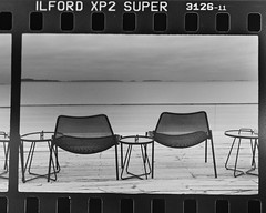Two chairs and a dull landscape (ristoranta) Tags: meri tuoli 2016 canoneos skannattu mv maisema bw esine löyly syksy filmi mustavalko sea chair