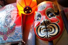 Pontocho mask (10 years of Flickr!) (Eric Flexyourhead) Tags: pontocho 先斗町 nakagyoku 中京区 kyoto 京都市 kansai 関西地方 japan 日本 city urban backstreet detail fragment shop store window display mask ricohgr