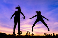 a moment of lightness (JimfromCanada) Tags: light lightness fly flying weightless hover hovering float floating sunset evening summer trampoline kids child children play fun playing youth childhood sky cloud