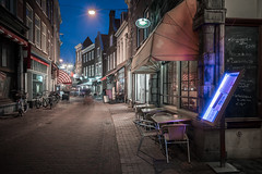 Catch of the day (McQuaide Photography) Tags: haarlem noordholland northholland netherlands nederland holland dutch europe sony a7rii ilce7rm2 alpha mirrorless 1635mm sonyzeiss zeiss variotessar fullframe mcquaidephotography lightroom adobe photoshop tripod manfrotto stad city urban lowlight architecture outdoor outside illuminated street straat langeveerstraat window wideangle wideanglelens groothoek building longexposure oldstreet old oud character traditional authentic streetlight atmosphere sfeer winter cobblestone cobbles restaurant horeca shadow light licht bluehour dusk twilight schemering babbels restaurantbabbels