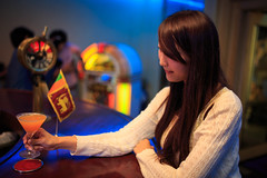 Young girl about to drink a cocktail at bar (Apricot Cafe) Tags: people glass japan bar night asian japanese togetherness sweet weekend lifestyle happiness cocktail yokohama lovely kanagawa 1person pleasant kanagawaken yokohamashi modelshooting sigma35mmf14dghsm img615040
