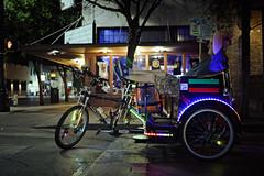 Pedi lights on 6th (Montage_Medley) Tags: color bicycle night austin lights texas cab pedicab atx