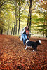 Playing with leaves (plant.wendy) Tags: dog bordercollie border collie me self portrait autumn leaves playing colors season fall yellow orange red green scarf jacket grey blackwhite happy happiness