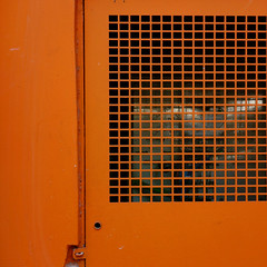 Forme indistinte dietro una grata arancione. Blurred shapes behind an orange grid (grids) (sandroraffini) Tags: abstract minimalism reality orange colorful metal door porta blurred behind vision urban exploration geometria grata grid forme shapes tecnico ciutat vella details monochrome monocromo square valencia spagna spain geometry sandroraffini sony rx100 servizio service optical illusion