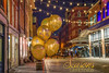 Seasons Greetings (JMS2) Tags: christmas night balloons glitter cobblestone southstreetseaport nyc manhattan shops stars