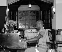 The Piano Man (Chris J0hnst0n) Tags: blackwhite piano jamaica