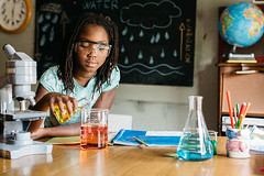 Science Experiment (gabster_ro) Tags: school test black water glass childhood bottle student education lab flask technology child classroom young experiment science research chemistry laboratory stockphotos learning knowledge africanamerican teaching copyspace chalkboard biology microscope liquid studying blackboard educate pouring backtoschool beaker academic scientific glassware royaltyfree erlenmeyerflask stocksy