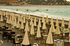waiting for the customers by the waves (2) (PDKImages) Tags: blue sea france art beach architecture buildings hotel bay nice cotedazur waves azure palmtrees prom shore parasol views promenade umbrellas elegance pergolas