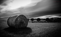 Mono Bale (Augmented Reality Images (Getty Contributor)) Tags: sunset storm field scotland farm country perthshire hay bales