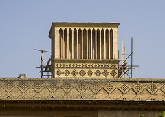 Windtower Of Traditional House, Fars Province, Shiraz, Iran (Eric Lafforgue) Tags: old travel tower history horizontal architecture facade work outdoors photography asia day scaffolding iran structures sunny persia nobody nopeople architectural adobe restoration renovations shiraz renovation orient clearsky repairs edifice edifices windtower partof famousplace  buildingexterior  lowangleview colourimage  iro iranianculture  builtstructure farsprovince  iran150286