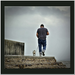 The walker (agphoto100) Tags: dog man walk walker rear stone concrete beach path pathway sky blue clouds jeans shoe leash nikon 1v1 manual lens photoshop photoscape frame schorncliffe jetty peir titan135mmf28