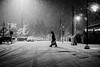 Wintry night (Warfield360) Tags: winter snow snowfall man human street city urban night streetlights shadows hat cold coat bag cars tiretracks leica weather storm yaugerpark