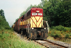 Freight Up (view2share) Tags: august221992 august1992 august 1992 wc wisconsincentral wisconsincentralltd lanse lansesub sdl39 emd electromotivedivision diesel railroad rr railway railroading railroads rail rails railroaders rring upperpeninsula uppermichigan northernmichigan northwoods northwood michigan mi baragacounty trains track train transportation tracks transport trackage trees travel freighttrain freight freightcars freightcar eastbound lansehill summer engine wc586 deansauvola