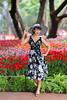 Spread her wings II (N.Jiraw) Tags: woman lady girl female asian thai thailand outdoor flower tree tulips hat beauty beautiful colors shorthair chiangrai