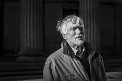 Most Illuminating (Leanne Boulton) Tags: people monochrome portrait urban street candid portraiture streetphotography candidstreetphotography candidportrait streetportrait eyecontact candideyecontact streetlife old elderly man male face facial expression look emotion feeling mood eyes beard grey tone texture detail depthoffield bokeh naturallight sunlight outdoor light shade shadow city scene human life living humanity society culture canon5d 5dmarkiii canon 5d 70mm character ef2470mmf28liiusm black white blackwhite bw mono blackandwhite glasgow scotland uk