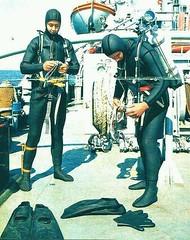 2 Vintage divers (Vintage Scuba) Tags: ocean lake man men wet water vintage belt tank mask smooth dry scuba diving rubber double hose suit diver beavertail weight drysuit fins wetsuit rebreather regulator