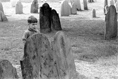 060568 29 (ndpa / s. lundeen, archivist) Tags: nick dewolf nickdewolf photographbynickdewolf blackwhite bw 1968 1960s 35mm june beaconhill candid boston massachusetts ma city citylife streetlife sliceoflife film monochrome blackandwhite spring cemetery graveyard buryingground granaryburyingground grave graves tombstone tombstones gravestone gravestones gravemarker gravemarkers child boy quentin